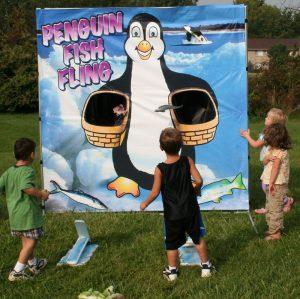 penguin fish fling game